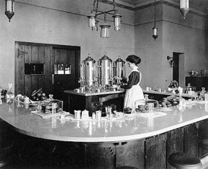 "A ""Harvey Girl"" pouring coffee in lunchroom at Lamy, New Mexico, in early 1910's. Photograph from Northern Arizona University."