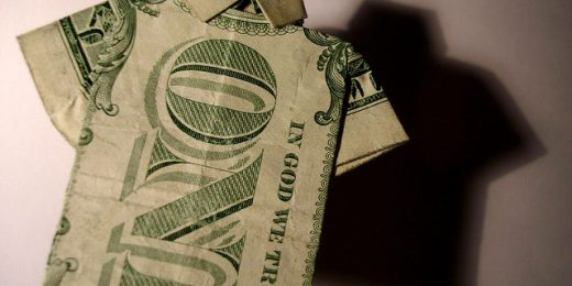 One-dollar bill shaped as a shirt
