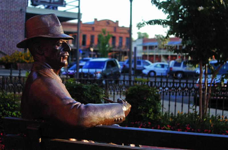 Statue of William Falkner on a park bench
